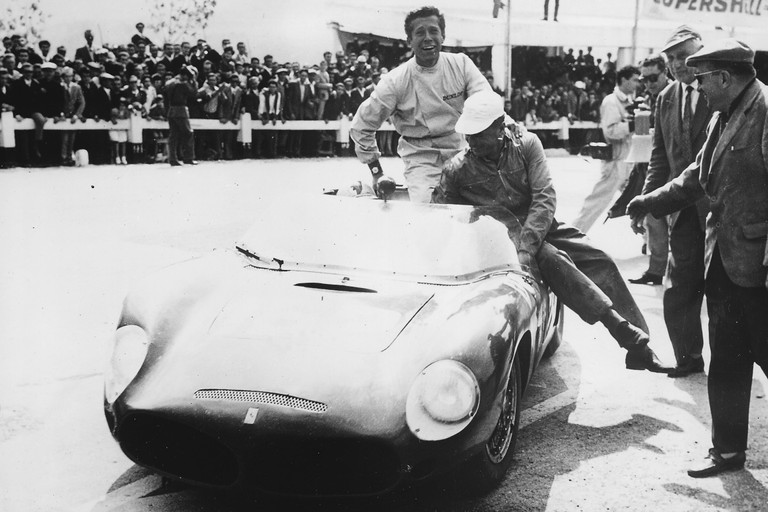From the Ferrari archive, copyright unknown  1961 Targa Florio  Olivier Gendebien smiles for the camera after congratulating teammate Wolfgang von Trips following the pair's 1961 Targa Florio victory