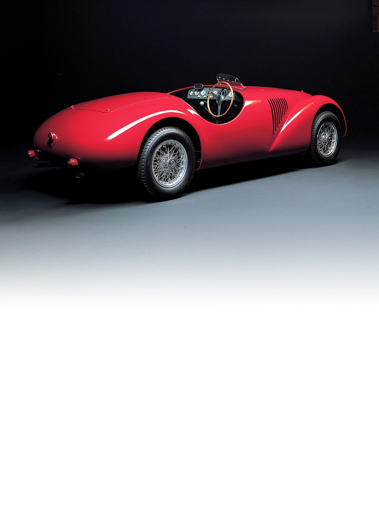 This was the very first car to wear the Ferrari badge. The V12 engine was designed by Gioacchino Colombo with contributions from Giuseppe Busso and Luigi Bazzi.