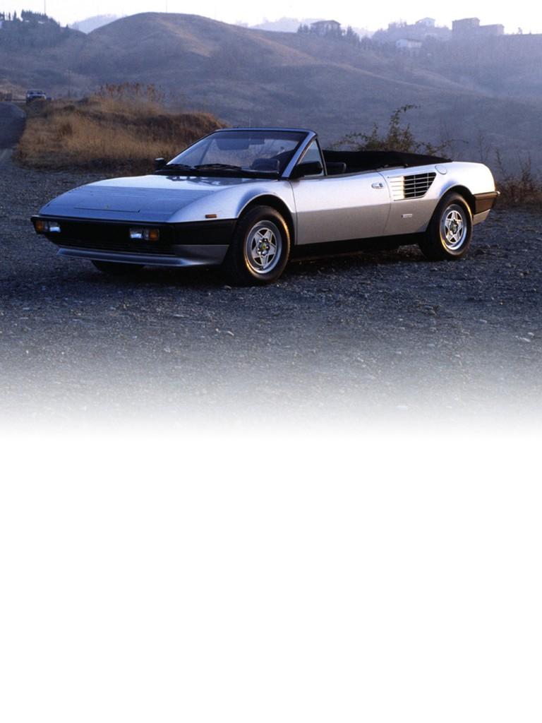 Ferrari Mondial Cabriolet: By a bit of canny engineering, Pininfarina managed to give the canvas top the same line as the coupé. In fact, it extended rearwards to include the two buttresses either side of the rear window, and Pininfarina's clever mechanism allowed the hood to fold away neatly behind the seats.