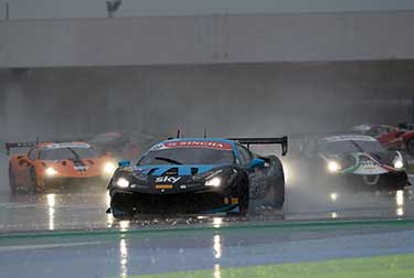 Tabacchi and Paulsen celebrate victory and championship in torrential rain.